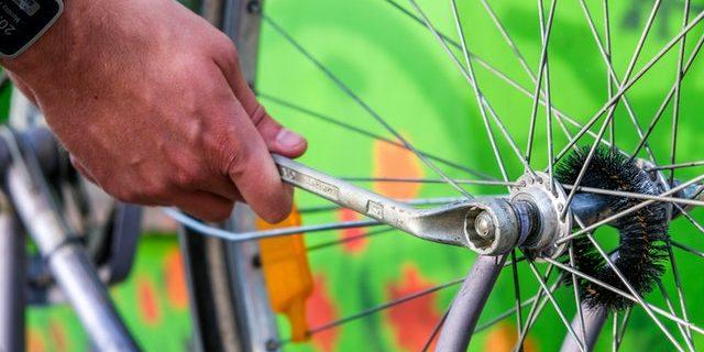 Bike being fixed – Greening Steyning, Bramber & Beeding